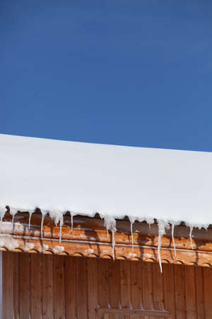 Icicles on a roof photo