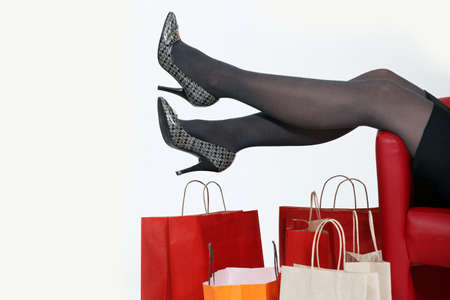 stockings feet: Woman relaxing at home after shopping trip