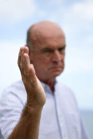 50 yrs: Stern bald man Stock Photo