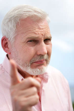 65 years old: Elderly man shaking his finger in disapproval Stock Photo