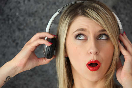 deafening: Blond woman with headphones