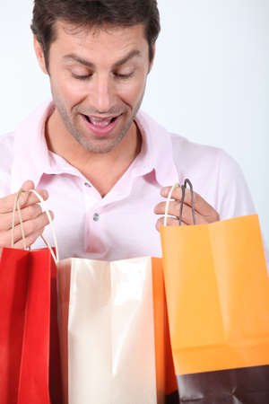 man with shopping bags photo