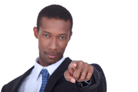 well dressed black man pointing his finger on us photo