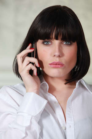 Attractive employee using cellphone Stock Photo - 26102733