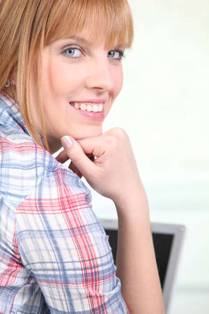 Red-haired woman with plaid shirt photo