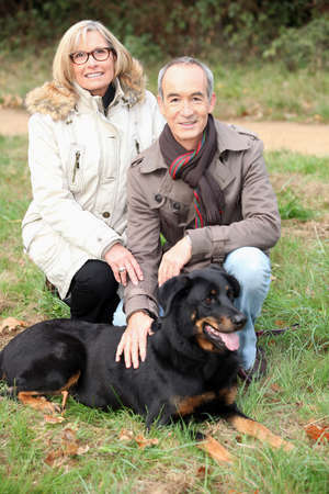 Older couple with a dog photo