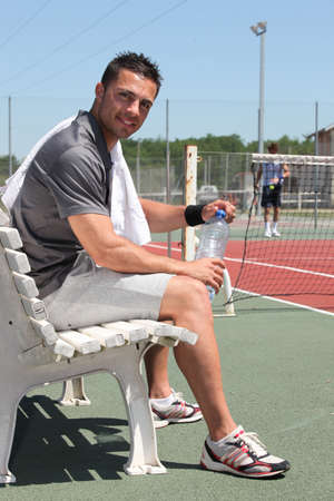 Tennis player on the bench photo