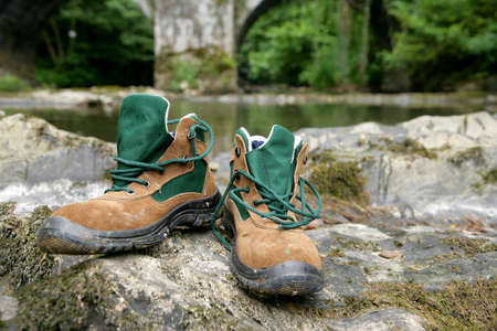 walking boots: Walking boots by a river