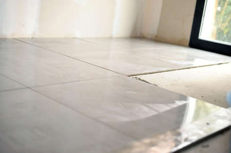Unfinished tile flooring Stock Photo