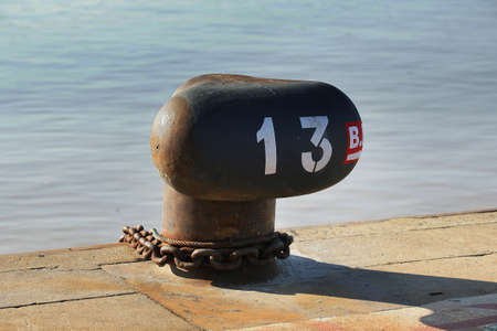punting: Numbered bollard at the pier Stock Photo