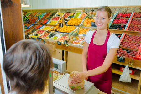 greengrocer: Greengrocer  serving a customer Stock Photo