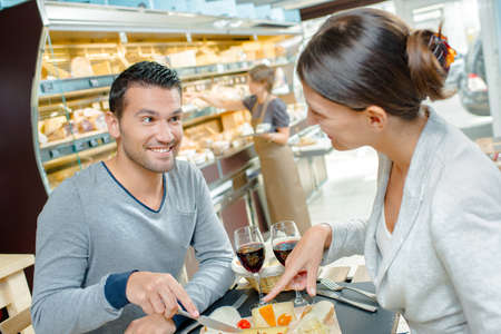 Couple having a romantic lunch photo