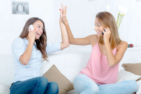 adultery: To female friends on the phone Stock Photo