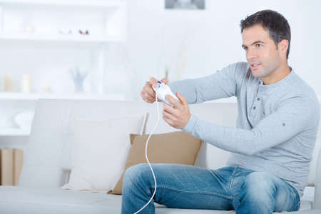 solitude: Man playing video games alone