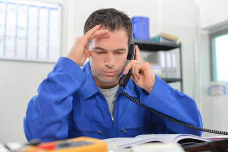 engineer's: Stressed manual worker on the phone