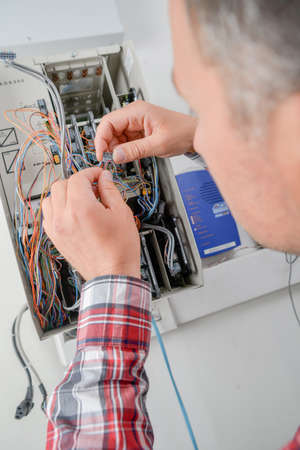 energy electrician: Electrican connecting fuse box