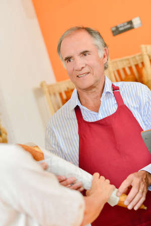 adultery: Baker serving a customer Stock Photo