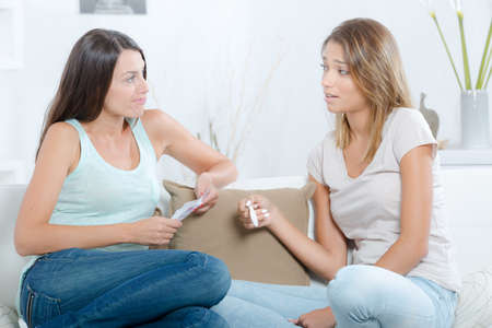 home pregnancy test: Two women looking at pregnancy test