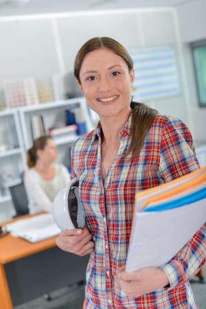female architect: Female architect carrying folders Stock Photo