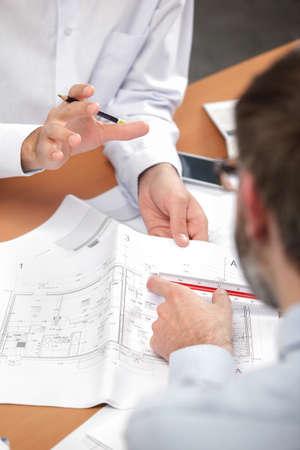 engineer's: Gathered around Architects Plans