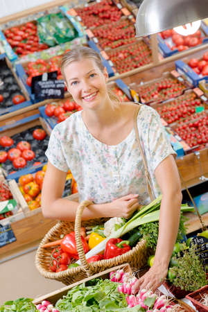 women s health: Some woman buying radishes Stock Photo