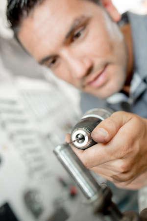 stickup: Mechanic using a power drill Stock Photo
