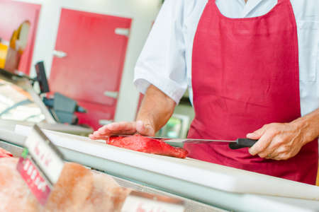hand cut: Cutting a piece of beef to order Stock Photo
