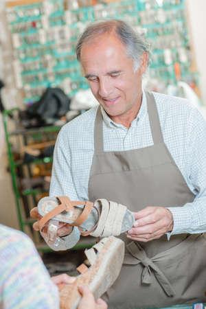shop skill: Man making replacement keys Stock Photo