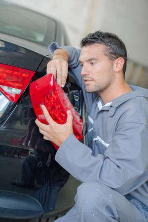 replacing: Mechanic Has the the replacing headlight