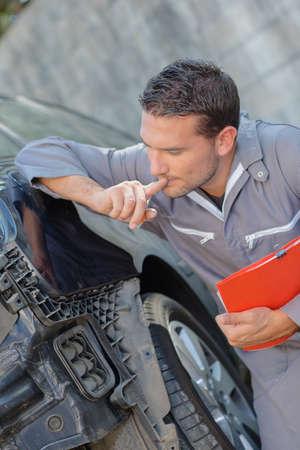 electronics industry: Because Mechanic inspecting damaged