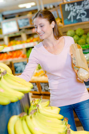 woman s bag: Consumer buying fruit Stock Photo
