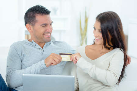 Playful Couple arguing over online shopping