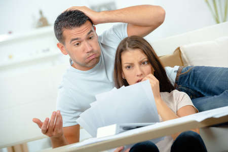 pertaining: Worried Couple looking at bills