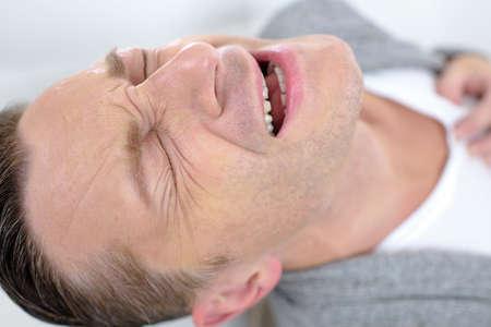 angina: Man having a heart attack Stock Photo