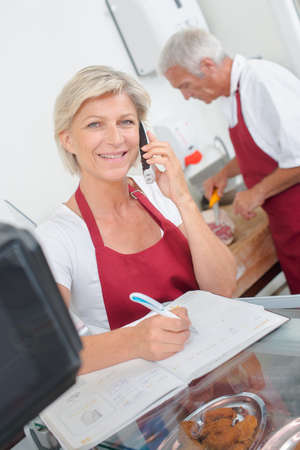 prime adult: Butcher couple ordering stock