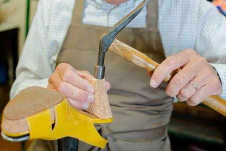 hammering: Cobbler hammering a shoe
