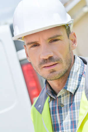 high visibility: Builder wearing high visibility vest Stock Photo