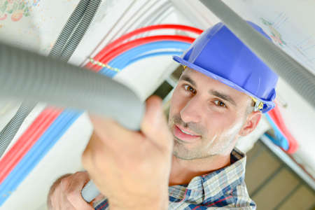 fan ceiling: Electrician wiring a ceiling