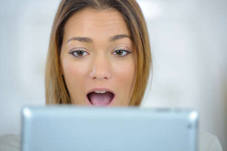 astounded: Surprised woman on computer Stock Photo