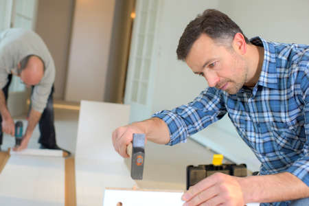 journeyman: Carpenter using a hammer Stock Photo