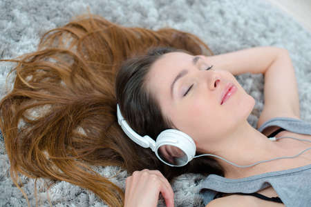 splayed: Lady listening to headphones