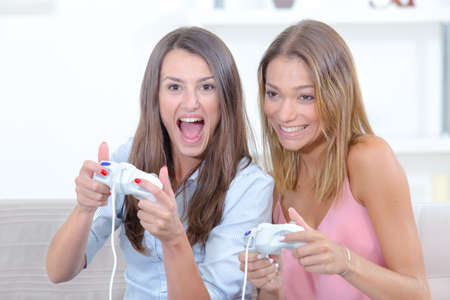 gamer: Two women playing video games