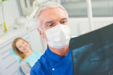 roentgenogram: Dentist checking x-ray before drilling Stock Photo