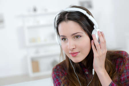 ear checked: Teenage girl listening to music Stock Photo