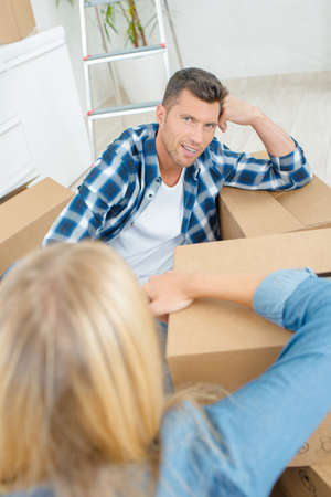 amongst: Couple amongst boxes Stock Photo