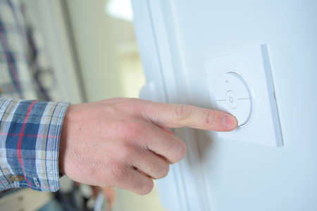 activating: Controlling temperature in home Stock Photo