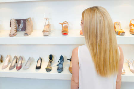 sandles: Blond woman shoe shopping Stock Photo