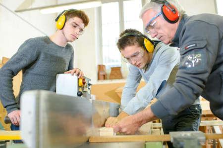 Woodwork apprenticeship Stock Photo