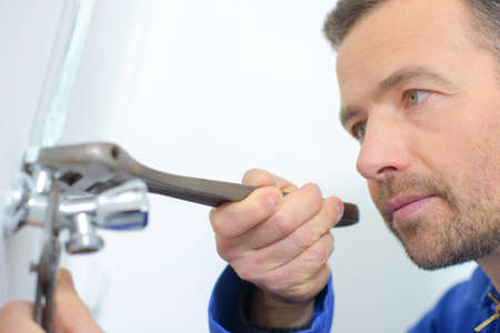 Experienced plumber Stock Photo
