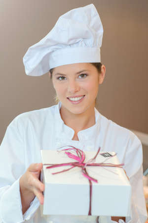 box: Patisserie chef holding a gift box